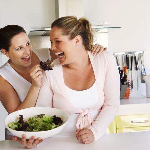 Friends eating salad --- Image by © Heide Benser/Corbis