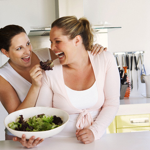 Friends eating salad --- Image by © Heide Benser/Corbis